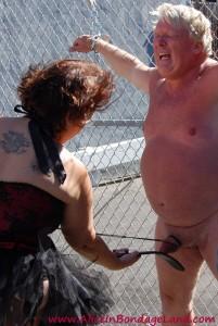 AliceInBondageLand - Folsom Street Fair - Chain Link Fence PUBLIC Ball Busting CBT